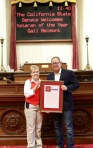 Senator Berryhill presenting Gail with Resolution #677