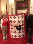 Showing the Senator a sample of a special Quilt of Honor